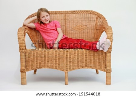 rattan sofa and relaxing girl