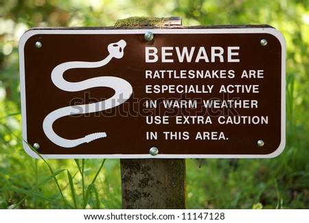 Rattlesnake Warning Sign - stock photo