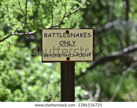 Rattlesnakes Only Beyond this Point Warning Sign