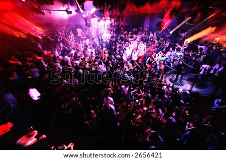Rave with Lens zoom of a packed dance floor - stock photo