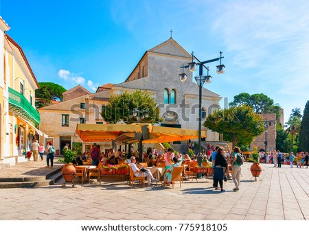 Ravello, Italy - October 2, 2017: People at street cafe on central square in Ravello village, Tyrrhenian sea, Amalfi coast, Italy