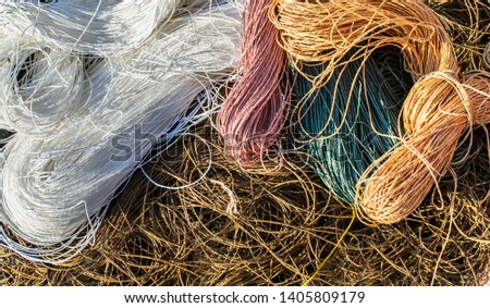 ravels of pastel (white, brown, pink, green and orange) color raphia ropes background Photo stock ©