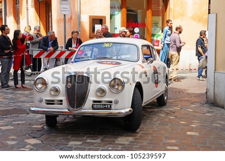 "RAVENNA, ITALY - MAY 18:  A LANCIA Aurelia B 20 S (1956) at the ""Mille miglia"" historical race for classic cars on May 18, 2012 in Ravenna, Italy."