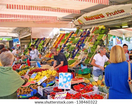 RAVENNA, ITALY MAY 21: fruits and vegetables vendor at the Wednesday outdoor market. The place is very popular in the city and attracts thousands of people. May 21, 2005 Ravenna Italy