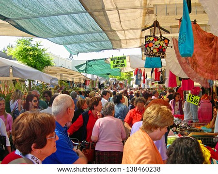 RAVENNA, ITALY MAY 21: locals and tourists at the Wednesday outdoor market. The place is very popular in the city and attracts thousands of people. May 21, 2005 Ravenna Italy