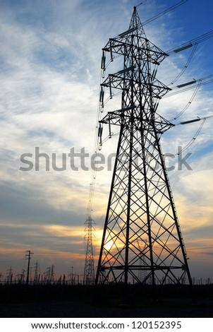 Ravenna, transmission lines at sunset. - stock photo
