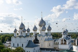 ravens flying between the copolas of the Assumption Cathedral, Rostov Veliky
