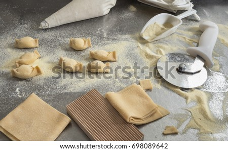Ravioli and fresh pasta ingredients Italian cuisine composition with utensils and ingredients  #698089642