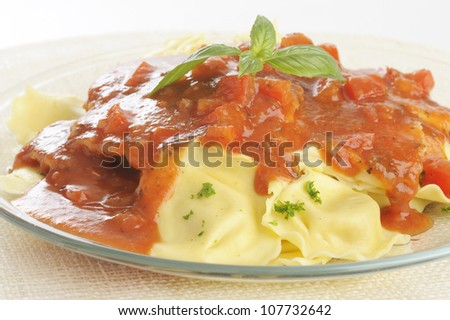 Ravioli pasta in a tomato and pepper sauce with salmon - girasole pasta