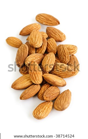 Raw almonds in a pile isolated on white background