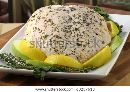 raw and juicy turkey breast seasoned with herbs, fresh and healthy food ready to go into the oven