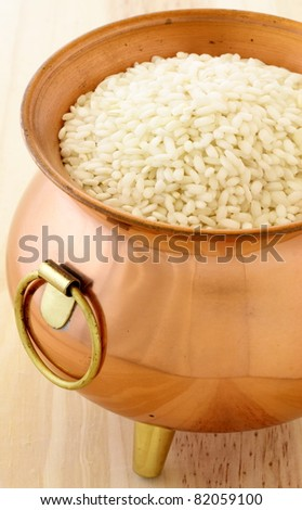 raw arborio rice used to make risotto, one of the most famous and delicious  Italian dishes