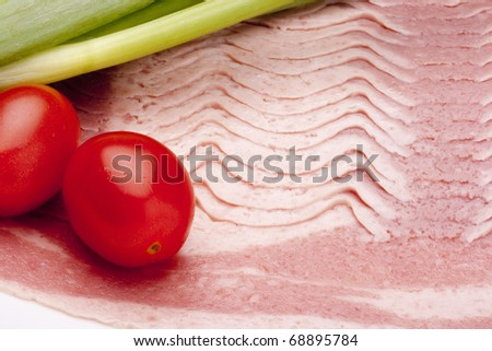 Raw bacon, cut thin slices, without packaging.