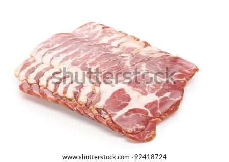 Raw bacon over white background