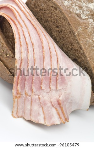 Raw bacon with bread over white background - stock photo