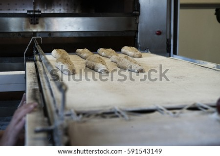 Raw baguette before oven #591543149