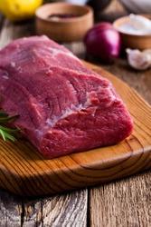 Raw beef fillet tenderloin on wooden cutting board, steak  with cooking ingredients