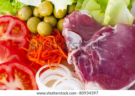 raw beef fillet with vegetables