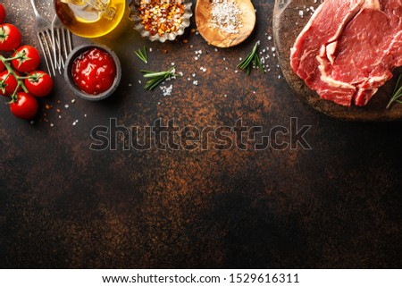 Raw beef meat on table with ingredients for cooking. Cooking background. Cooking concept. Banner. Horizontal