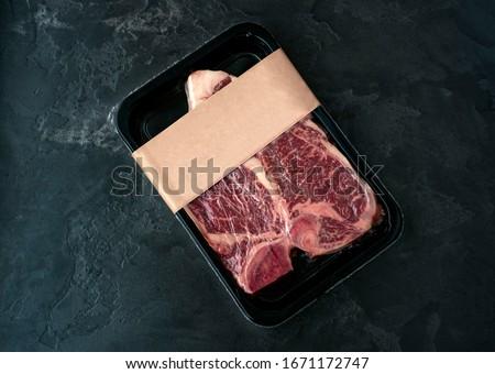 Raw beef steak t-bone in vacuum Packed, mockup for design idea