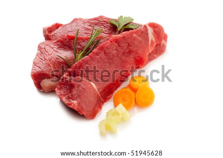 raw beef steak with ingredients