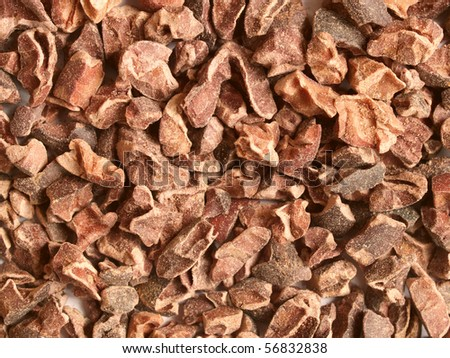 Raw cacao nibs; close-up; can be used as a background