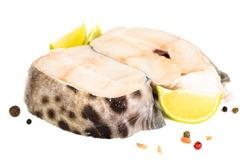 Raw catfish steak meat lime salt amd pepper studio isolated on white background