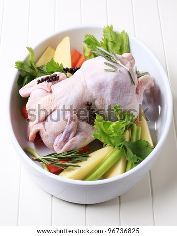 Raw chicken and vegetables