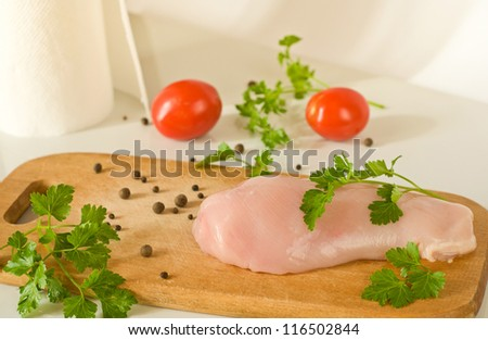raw chicken breast fillet, parsley and tomato