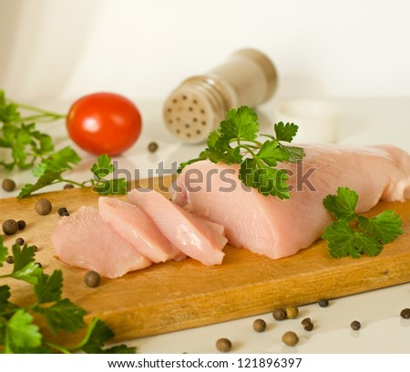 raw chicken breast fillet, spices and parsley