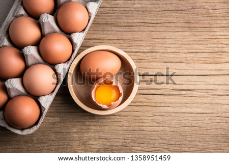 Raw chicken eggs organic food for good health high protein on rustic wooden background