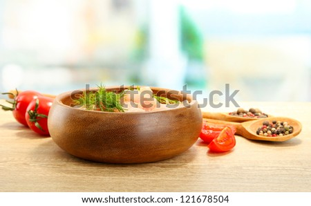 raw chicken meat in bowl, on wooden table