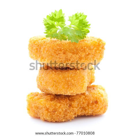 raw chicken nuggets stacked isolated on white background