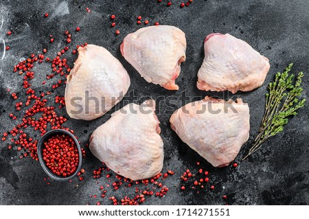 Raw chicken thigh with skin, organic meat. Black background. Top view ストックフォト ©
