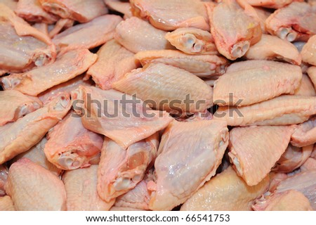 Raw Chicken Wings in supermarket.