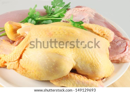 Raw chicken with parsley