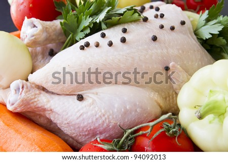 Raw chicken with pepper and vegetables ready to be prepared