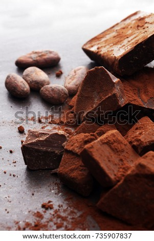 Raw cocoa beans, cocoa powder and chocolate pieces. #735907837