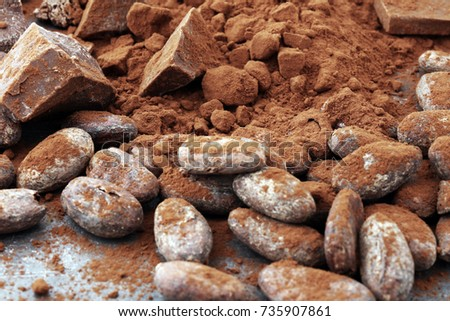 Raw cocoa beans, cocoa powder and chocolate pieces. #735907861