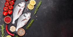 Raw dorado fish with spices cooking on cutting board. Fresh fish dorado