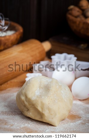 Raw dough with baking ingredients for baking Christmas cookies