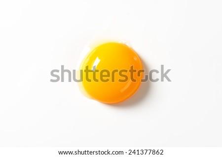 Raw egg yolk on white background Сток-фото ©