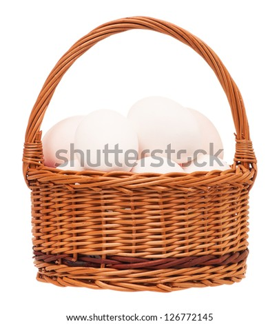 Raw eggs in a wicker basket isolated on white background