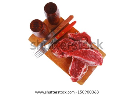 raw fillet mignon on cutting board prepared for roasting