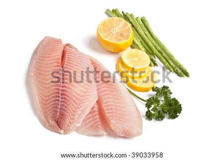 Raw Filleted Fish with Asparagus, Parsley and Lemon on White