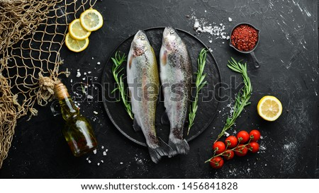 Raw fish trout on a plate. Top view. Free space for your text. Stock photo ©
