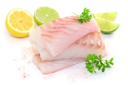 Raw fish with lemon and lime on white background, isolated.