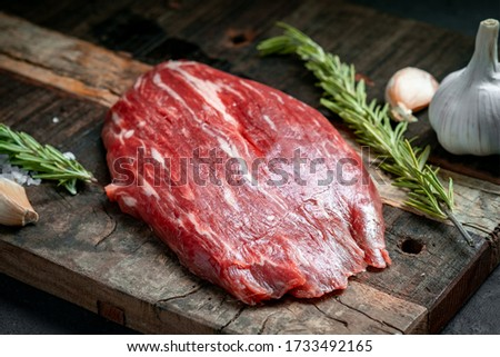 Raw flank beef steak and ingredients for cooking on a wooden Board, close up Photo stock ©
