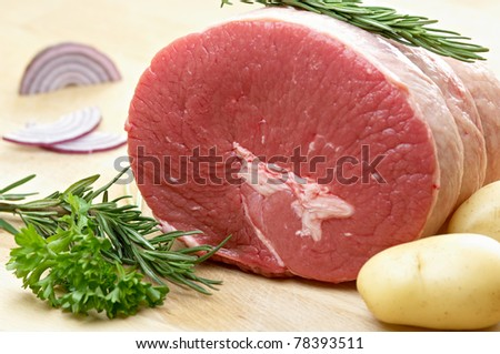 raw food, roast bee, rosemary, potatoes, onion and parsley