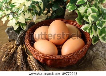 Raw fresh eggs in a basket